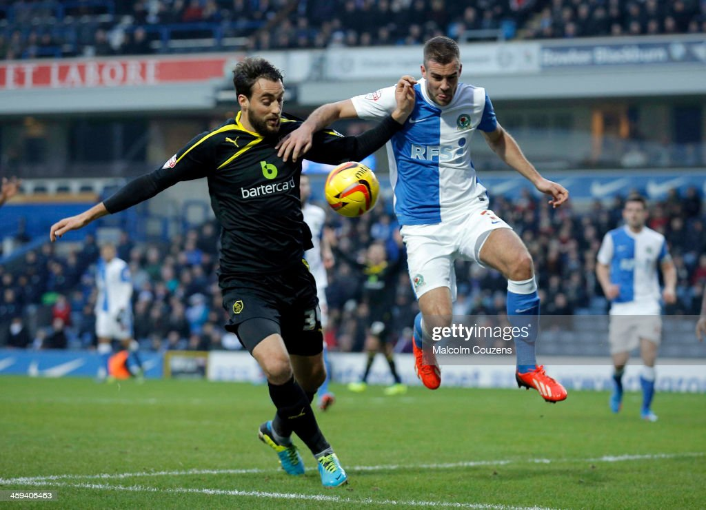Tommy Spurr of Blackburn Rovers (R) competes with Atdhe Nuhiu of Sheffield Wednesday during the Sky Bet Championship match between Blackburn Rovers and Sheffield Wednesday at Ewood Park on December 26, 2013 in Blackburn, England.