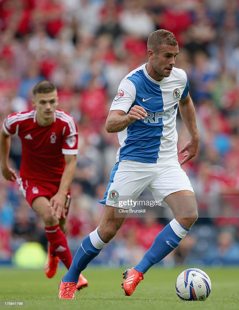 Tommy Spurr of Blackburn Rovers moves away from Jamie Paterson of Nottingham Forest during the Sky Bet Championship match between Blackburn Rovers and Nottingham Forest at Ewood Park on August 10, 2013 in Blackburn, England,