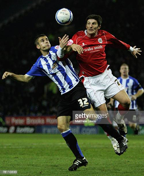 Tommy Spurr of Sheffield and Jon Macken of Barnsley challenge for the ball during the CocaCola Championship match between Sheffield United and...