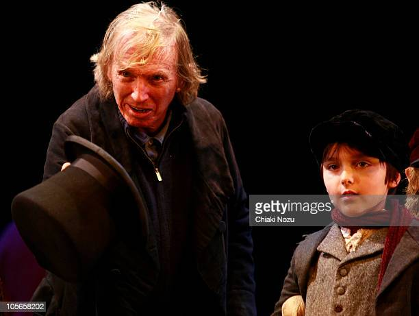 Tommy Steele and a team of local children who will be appearing alongside him in new musical 'Scrooge' pose at a photocall at New Wimbledon Theatre...