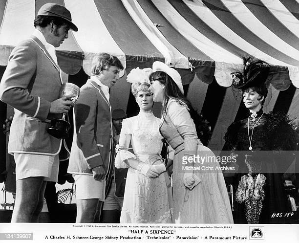 Tommy Steele and Julia Foster argue as Penelope Horner watches in a scene from the film 'Half A Sixpence' 1967