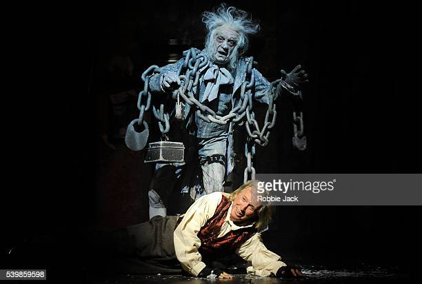 Tommy Steele as Ebenezer Scrooge and Barry Howard as Jacob Marley in Scrooge the Musical at the London Palladium