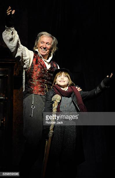 Tommy Steele as Ebenezer Scrooge and JamesTobias Norrington as Tiny Tim in Scrooge the Musical at the London Palladium
