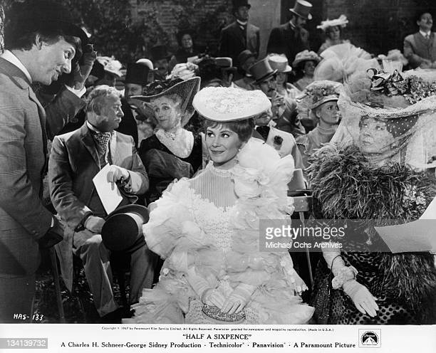 Tommy Steele tipping his hat to Penelope Horner in a scene from the film 'Half A Sixpence' 1967