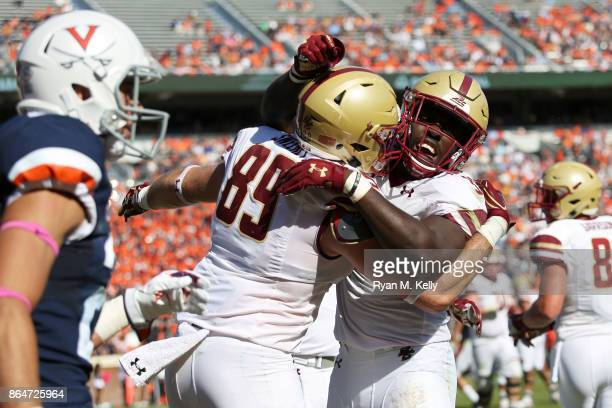 Tommy Sweeney and Jon Hilliman of the Boston College Eagles celebrate a touchdown in the third quarter during a game against the Virginia Cavaliers...