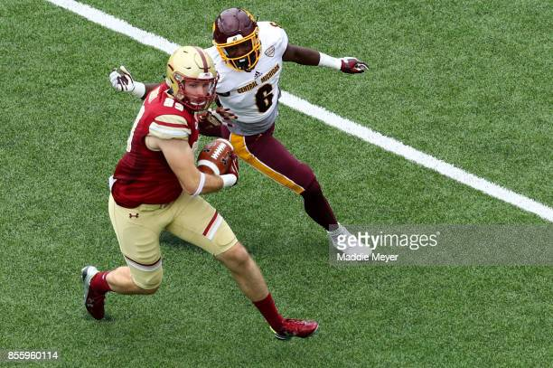 Tommy Sweeney of the Boston College Eagles makes a catch ahead of Da'Quaun Jamison of the Central Michigan Chippewas during the first quarter at...