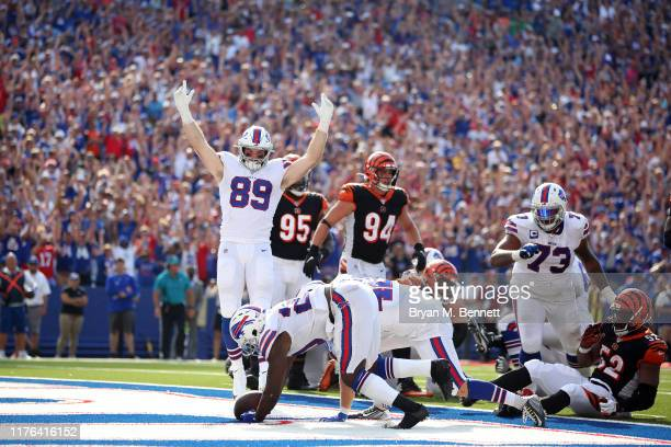 Tommy Sweeney of the Buffalo Bills celebrates after Frank Gore of the Buffalo Bills scores a touchdown during the fourth quarter of a game against...