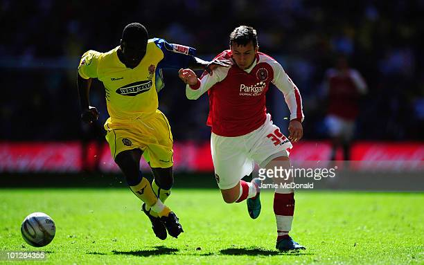 Tommy TejanSie of Dagenham battles with Adame Fondre of Rotherham during the Coca Cola League Two Playoff Final between Dagenham and Redbridge and...