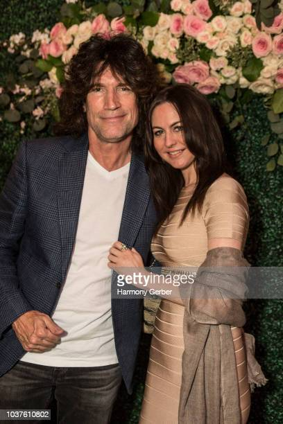 Tommy Thayer and Amber Peek pose for a photo at the Eastwood Ranch Foundation Gala on September 21 2018 in Westlake Village California