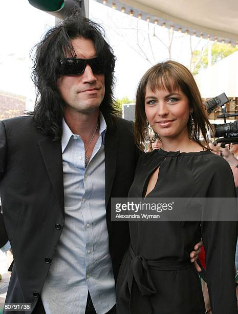 Tommy Thayer and Wife Amber arrives at 'A Plumm Summer' Premiere on April 20 2008 at Mann Bruin Theater in Westwood California