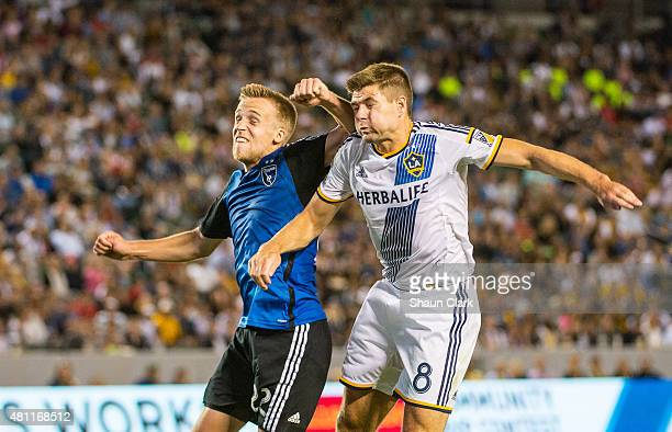 Tommy Thompson of San Jose Earthquakes elbows Steven Gerrard of Los Angeles Galaxy during Los Angeles Galaxy's MLS match against San Jose Earthquakes...