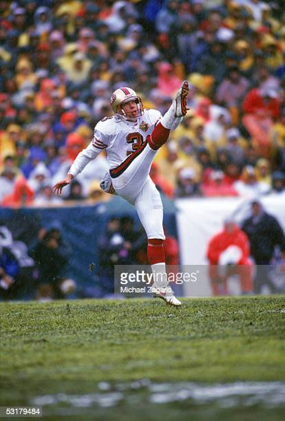 Tommy Thompson of the San Francisco 49ers punts against the Green Bay Packers during the 1996 NFC Divisional Playoff game at Lambeau Field on January...