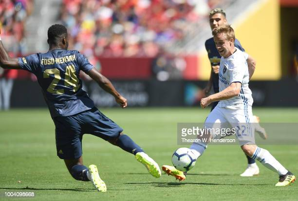 Tommy Thompson of the San Jose Earthquakes passes the ball past Timothy FosuMensah of Manchester United during the second half of their exhibition...