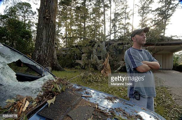 Tommy Townsend stands in front of his damaged car and home the day after Hurricane Katrina made her way inland August 30 2005 in Meridian Mississippi...