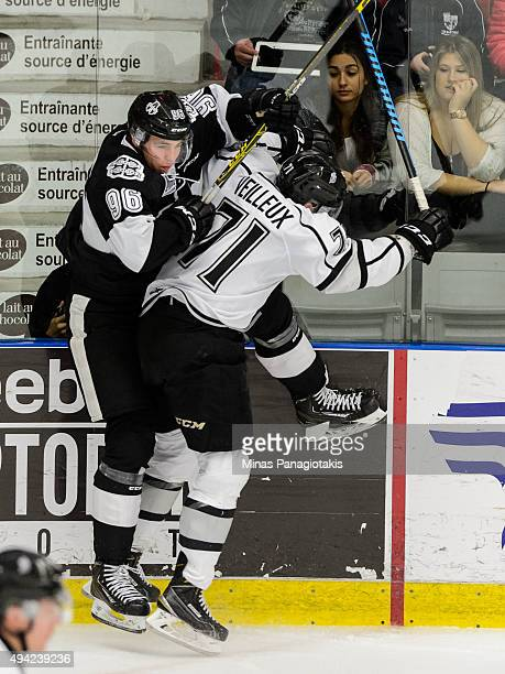 Tommy Veilleux of the Gatineau Olympiques checks Kristian Pospisil of the BlainvilleBoisbriand Armada during the QMJHL game at the Centre...