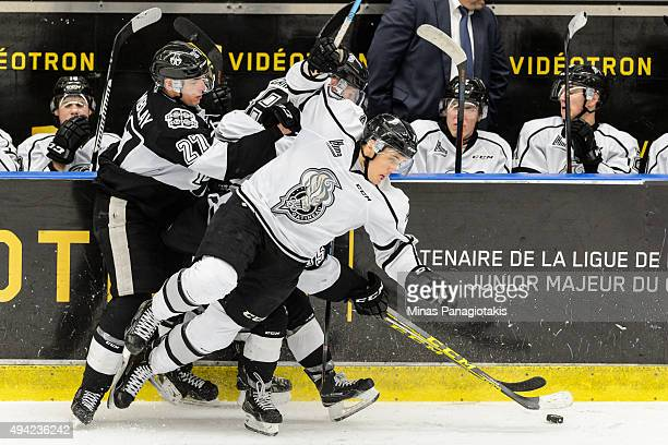 Tommy Veilleux of the Gatineau Olympiques falls near Samuel Tremblay of the BlainvilleBoisbriand Armada during the QMJHL game at the Centre...