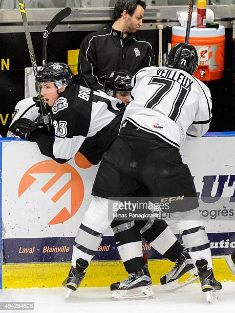 Tommy Veilleux of the Gatineau Olympiques pins Connor Bramwell of the BlainvilleBoisbriand Armada against the boards during the QMJHL game at the...