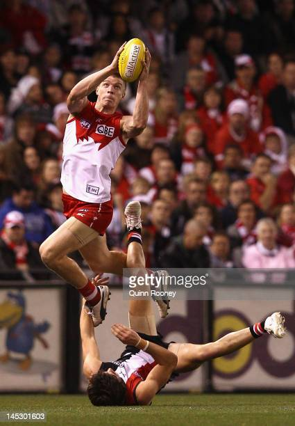 Tommy Walsh of the Swans marks over the top of Farren Ray of the Saints during the round nine AFL match between the St Kilda Saints and the Sydney...