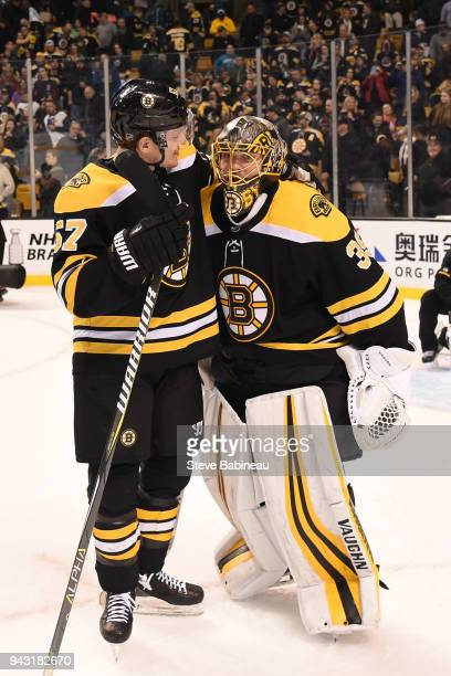 Tommy Wingels and Anton Khudobin of the Boston Bruins hug after the win against the Ottawa Senators at the TD Garden on April 7 2018 in Boston...
