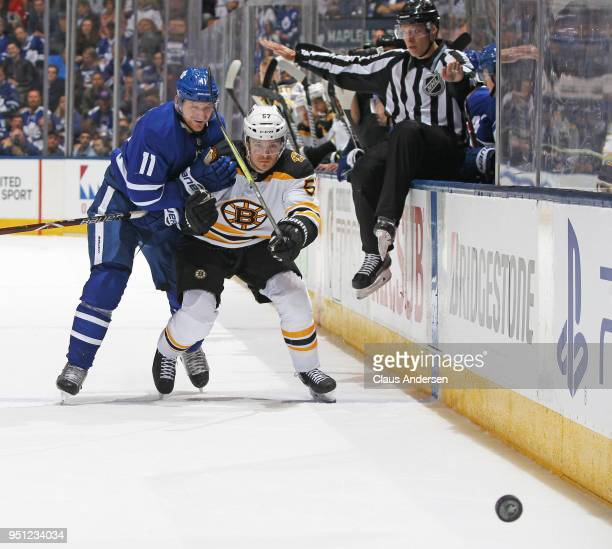 Tommy Wingels of the Boston Bruins battles against Zach Hyman of the Toronto Maple Leafs in Game Six of the Eastern Conference First Round in the...