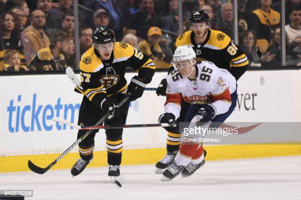 Tommy Wingels of the Boston Bruins skates against Henrik Borgstrom of the Florida Panthers at the TD Garden on March 31 2018 in Boston Massachusetts
