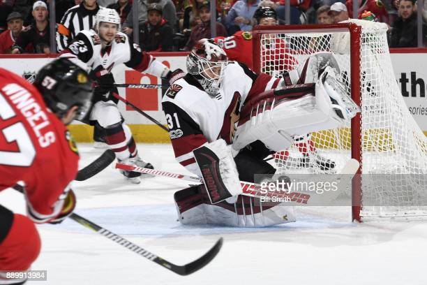 Tommy Wingels of the Chicago Blackhawks scores on goalie Scott Wedgewood of the Arizona Coyotes in the third period at the United Center on December...
