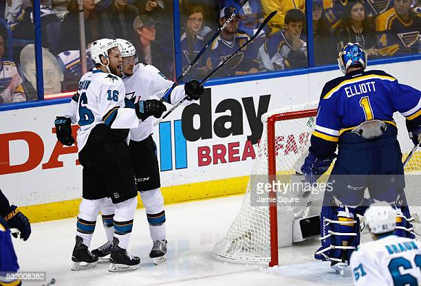 Tommy Wingels of the San Jose Sharks celebrates with Nick Spaling after scoring a first period goal against Brian Elliott of the St Louis Blues in...
