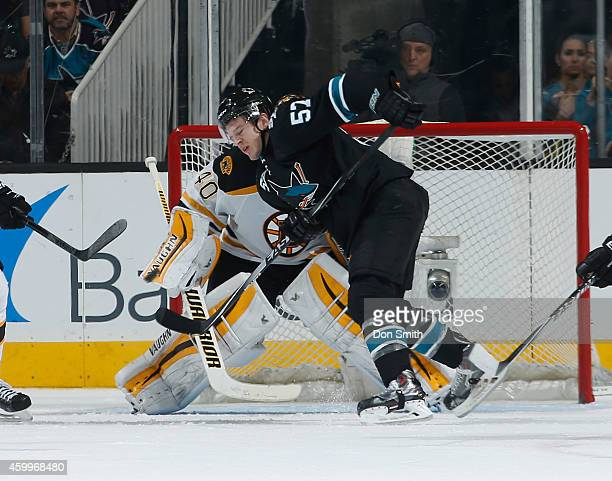 Tommy Wingels of the San Jose Sharks creates traffic in front of the net against Tuukka Rask of the Boston Bruins during an NHL game on December 4,...