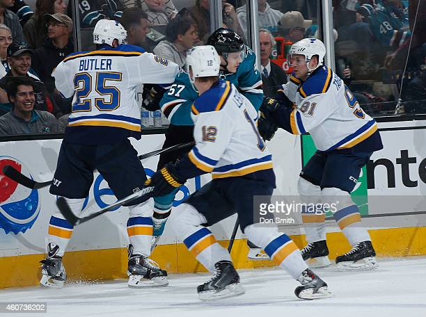 Tommy Wingels of the San Jose Sharks gets blocked off against Chris Butler Jori Lehtera and Vladimir Tarasenko of the St Louis Blues during an NHL...