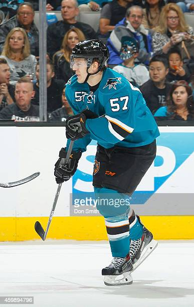 Tommy Wingels of the San Jose Sharks skates after the puck against the Anaheim Ducks during an NHL game on November 29, 2014 at SAP Center in San...