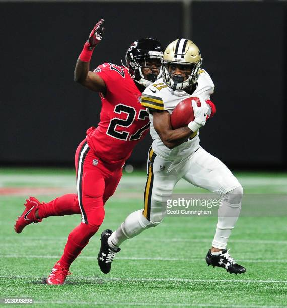 Tommylee Lewis of the New Orleans Saints carries the ball against Damontae Kazee of the Atlanta Falcons at MercedesBenz Stadium on December 7 2017 in...