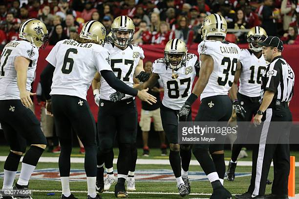 Tommylee Lewis of the New Orleans Saints celebrates making a play during the second half against the Atlanta Falcons at the Georgia Dome on January 1...