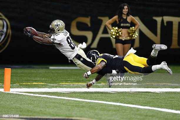 Tommylee Lewis of the New Orleans Saints dives for a touchdown as Jordan Dangerfield of the Pittsburgh Steelers attempts to tackle during the second...