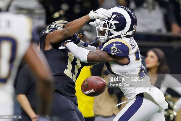 Tommylee Lewis of the New Orleans Saints drops a pass broken up by Nickell RobeyColeman of the Los Angeles Rams during the fourth quarter in the NFC...