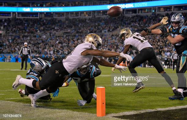 Tommylee Lewis of the New Orleans Saints fumbles against the Carolina Panthers in the fourth quarter during their game at Bank of America Stadium on...
