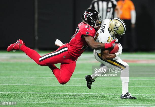 Tommylee Lewis of the New Orleans Saints is tackled by Damontae Kazee of the Atlanta Falcons at MercedesBenz Stadium on December 7 2017 in Atlanta...