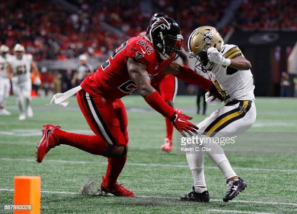 Tommylee Lewis of the New Orleans Saints side steps a tackle by Keanu Neal of the Atlanta Falcons on the way to scoring a touchdown at MercedesBenz...