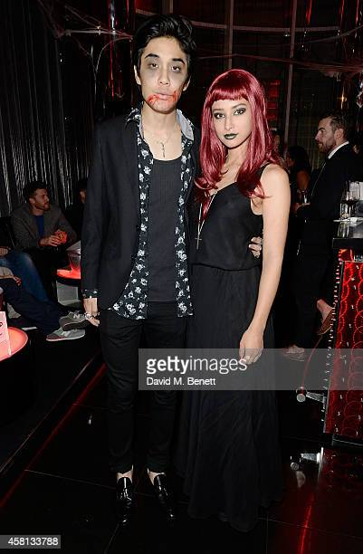 Tomo Kurata and Leah Weller attend Nightmare on Wardour Street at Wyld Bar on October 30 2014 in London United Kingdom