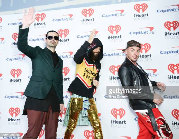 Tomo Milicevic Jared Leto and Shannon Leto of music group Thirty Seconds to Mars arrive at the 2017 iHeartRadio Music Festival at TMobile Arena on...