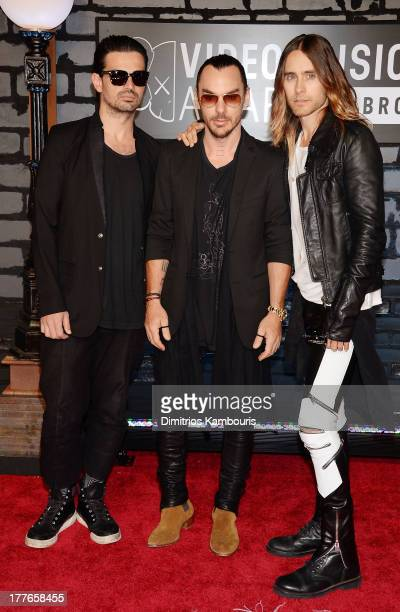 Tomo Milicevic Shannon Leto and Jared Leto of Thirty Seconds to Mars attend the 2013 MTV Video Music Awards at the Barclays Center on August 25 2013...