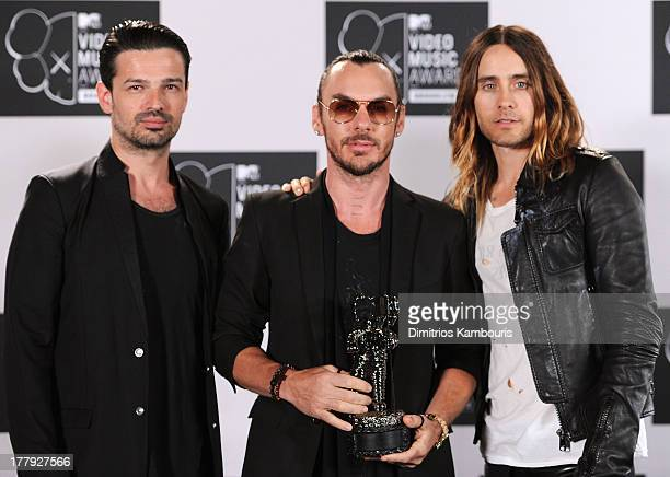 Tomo Milicevic Shannon Leto and Jared Leto of Thirty Seconds to Mars pose with Best Rock Video award in the press room at the 2013 MTV Video Music...