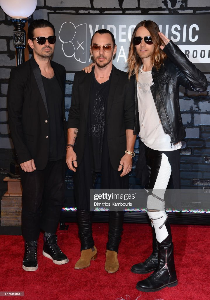Tomo Milicevic, Shannon Leto and Jared Leto of Thirty Seconds to Mars pose in the press room at the 2013 MTV Video Music Awards at the Barclays Center on August 25, 2013 in the Brooklyn borough of New York City.