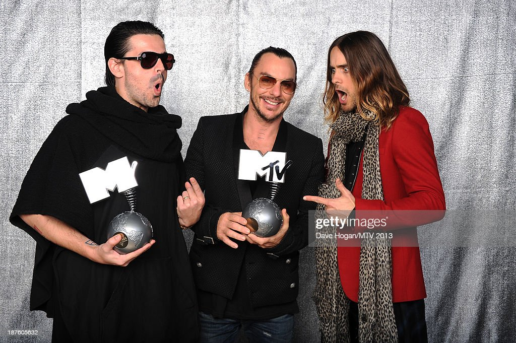 Tomo Milicevic, Shannon Leto and Jared Leto of Thirty Seconds To Mars pose with the Best Alternative award in the Exclusive Backstage Studio at the MTV EMA's 2013 at the Ziggo Dome on November 10, 2013 in Amsterdam, Netherlands.