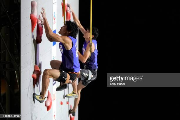Tomoa Narasaki of Japan and Meichi Narasaki of Japan compete in the Speed during Combined Men's Qualification on day nine of the IFSC Climbing World...
