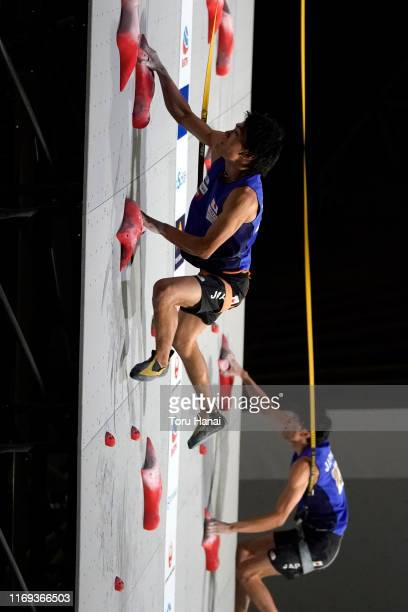 Tomoa Narasaki of Japan and Meichi Narasaki of Japan compete in the Speed during Combined Men's Final on day eleven of the IFSC Climbing World...