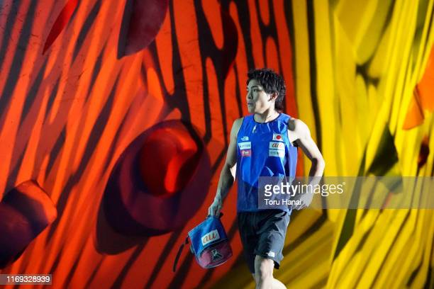 Tomoa Narasaki of Japan arrives to compete in the Bouldering during Combined Men's Final on day eleven of the IFSC Climbing World Championships at...