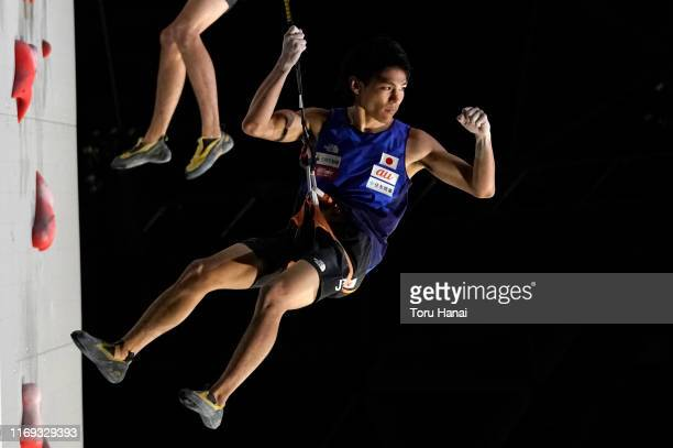 Tomoa Narasaki of Japan celebrates after competing in the Speed during Combined Men's Final on day eleven of the IFSC Climbing World Championships at...