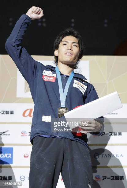 Tomoa Narasaki of Japan celebrates after winning the men's combined final at the sport climbing world championships in Hachioji western Tokyo on Aug...