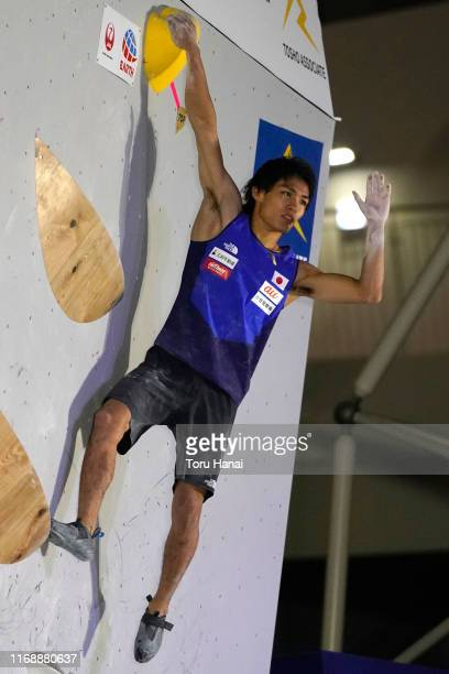 Tomoa Narasaki of Japan celebrates while competing in the Bouldering during Combined Men's Qualification on day nine of the IFSC Climbing World...