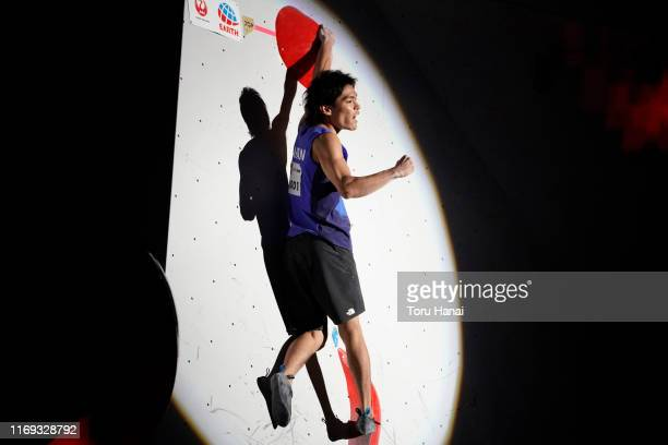 Tomoa Narasaki of Japan celebrates while competing in the Bouldering during Combined Men's Final on day eleven of the IFSC Climbing World...